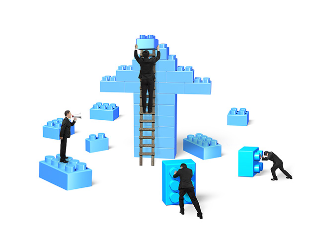 Business men building stack blocks in arrow up shape, isolated on white background. Teamwork concept.